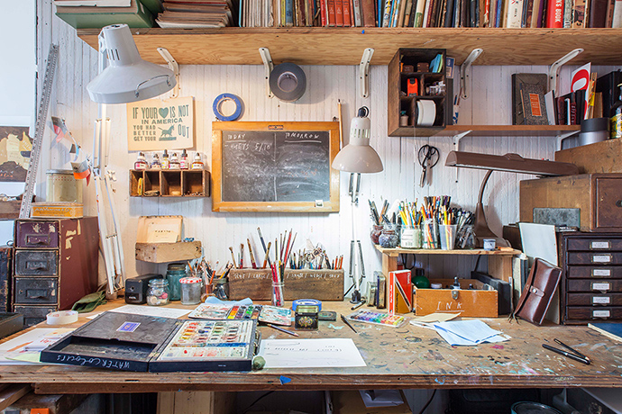 illustrator Oliver Jeffers' studio with paints and pens on table